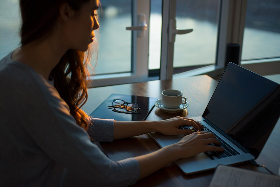 woman on laptop working from home