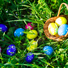 easter basket on grass with easter eggs